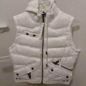 Ivory puffer sleeveless hoodie jacket.